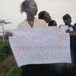 Woman with placard protests against Shell Nigeria in Kolo Creek, 7 July 2011, courtesy of Morris Alagoa, ERA-FoE Nigeria 3