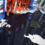 Greenpeace members simulate an oil spill during a protest in Rio de Janeiro