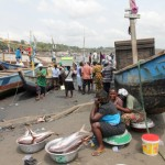 "Fishmongers shown in Sekondi, now Sekondi-Takoradi, is Ghana's ""Oil City."" Fishermen here are among those whose operations have been impacted by the oil development. Like all the fishermen in the ""frontline communities,"" they are extremely worried about oil spills. Christiane Badgley/ICIJ"
