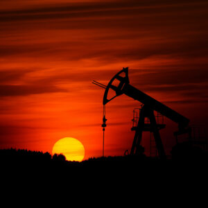 Oil derrick at sunset